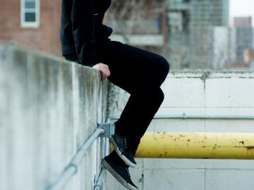 young person on a wall